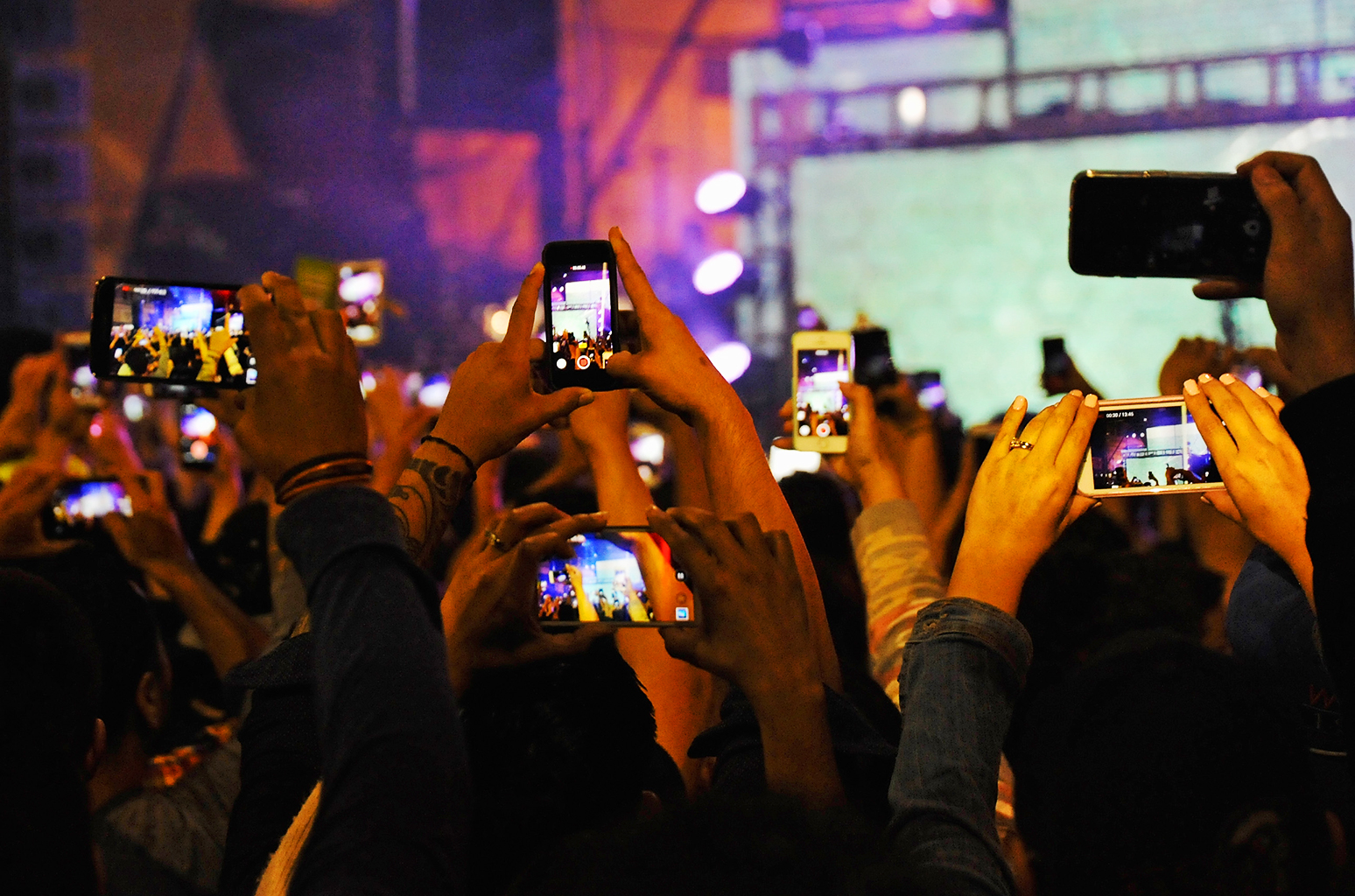 Image result for cell phones at a concert