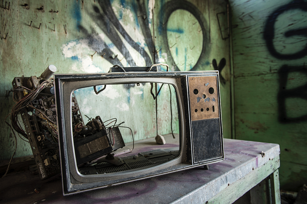 broken ruined destroyed damaged vintage television in abandoned graffitied room image by tina rataj berard on unsplash