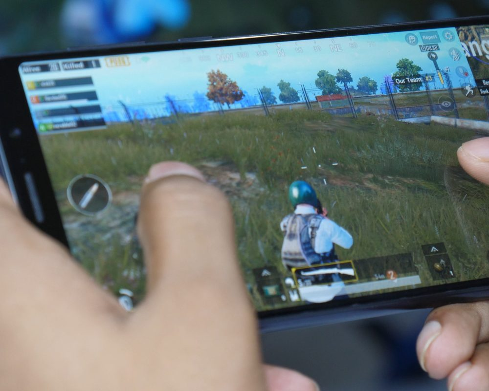 Someone playing PubG on a handheld device