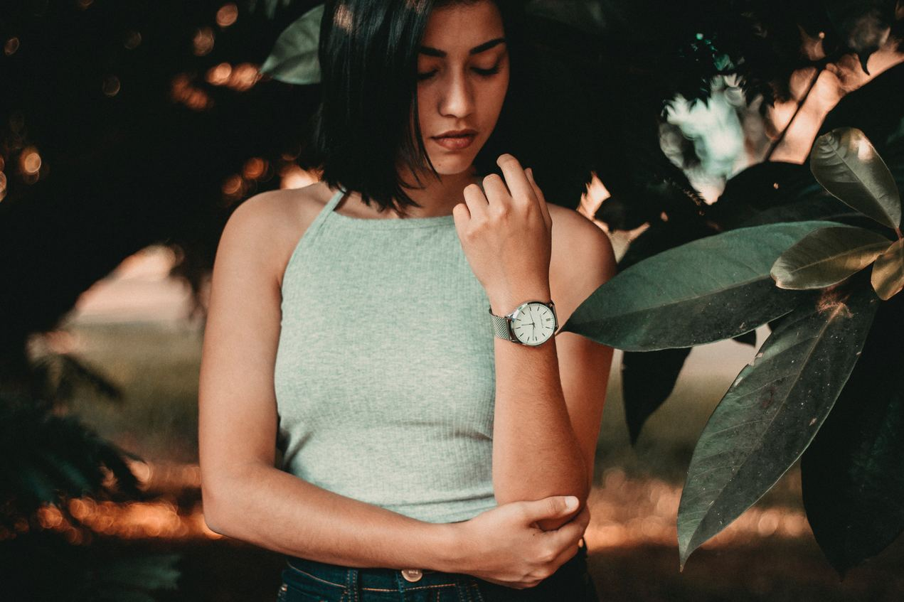 A woman stares at her watch; the biological clock is always ticking, and for some people, egg freezing is a great way to fight back