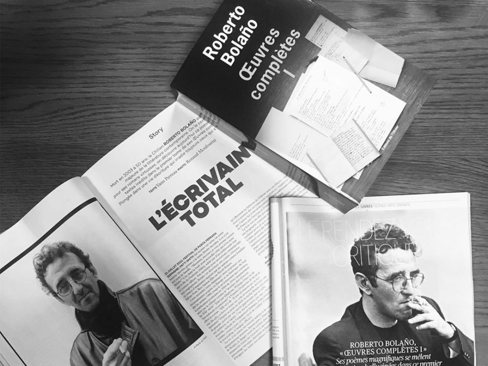 Photo of a Roberto Bolano book along with magazine articles about the author